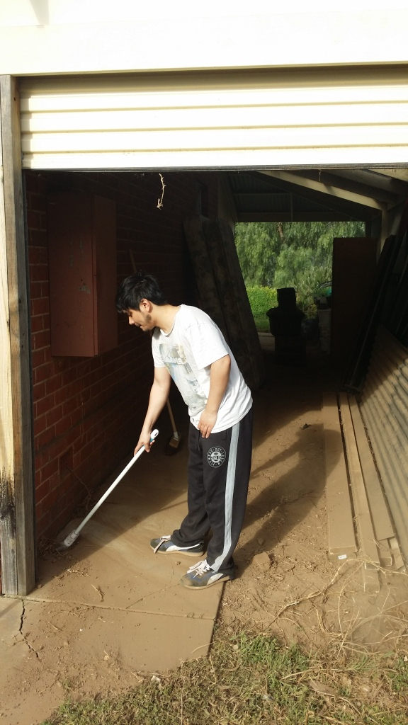 Marlon cleaning out the carport.