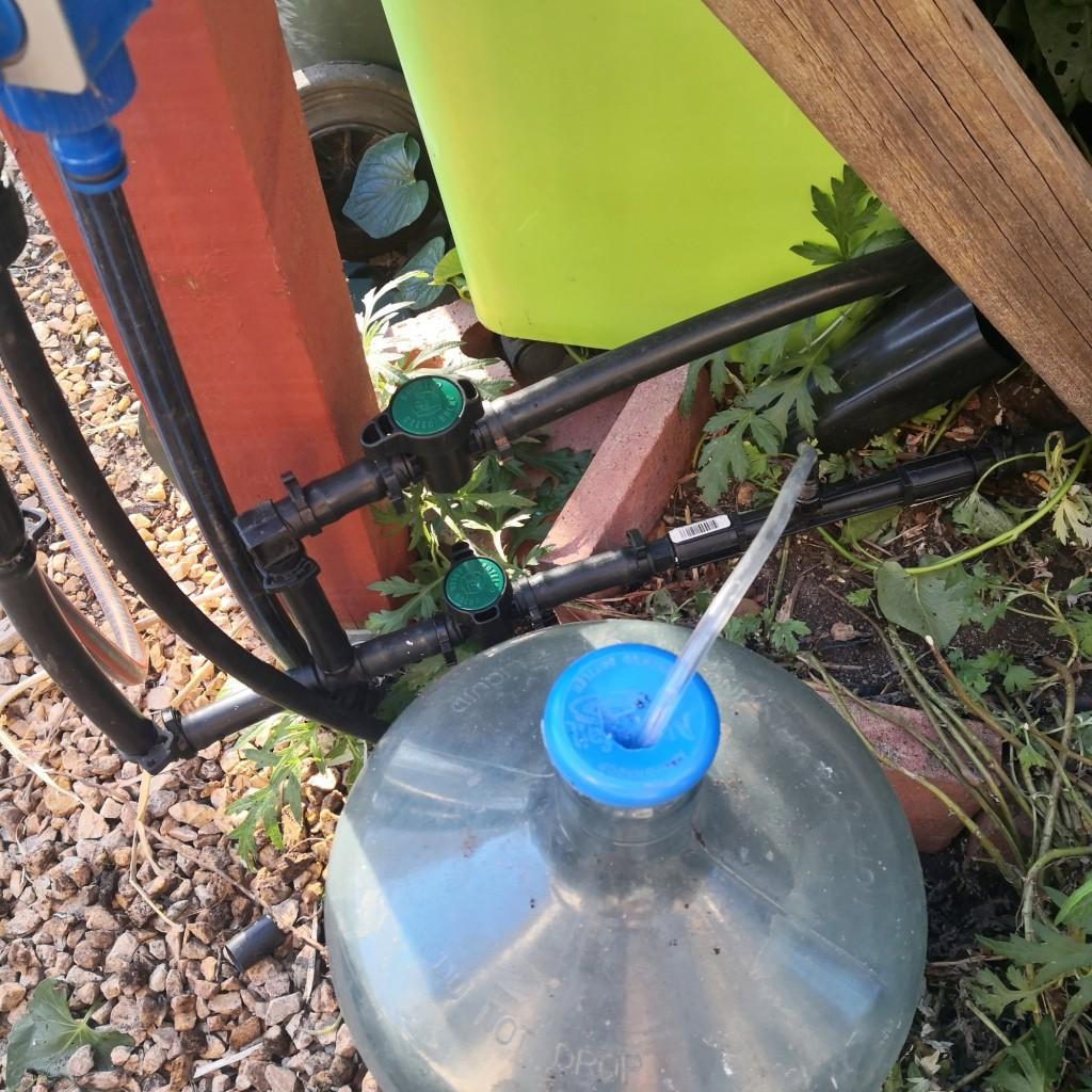 The venturi and fertilizer bottle installed.